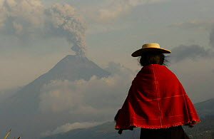 Salasacan indian with Tungurahua volcano smoking in background, Andes, Ecuador - Pete Oxford