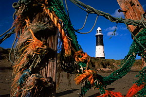 Fishermen's ropes and Spurn point lighthouse, East Yorkshire, UK - STEVE KNELL