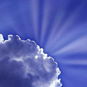Blue sky and clouds with sunbeams.  -  Mark Taylor
