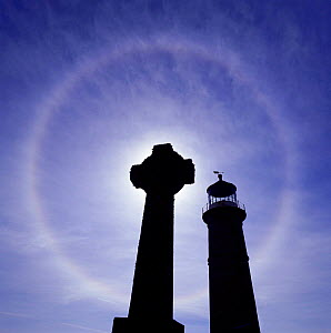 Halo around the sun with gravestones + lighthouse in the foreground, Lundy Island, UK. - Mark Taylor