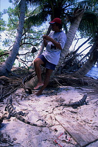 Man and Land iguanas, Sian Ka'an Biosphere Reserve, Mexico. - Daniel Gomez