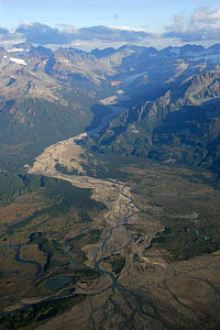 Aerial view of braided river channel and alluvial fan flowing into coastal creek, Alaska. - Pete Cairns
