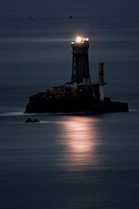 The Lighthouse La Vieille at night in front of the Pointe du Raz, Brittany, France.  -  Christophe Courteau