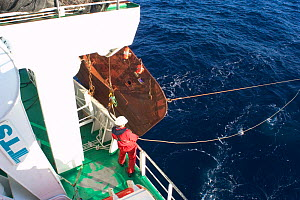 Releasing deep sea marine sampling equipment  from aft deck of GO Sars, Atlantic ocean - David Shale