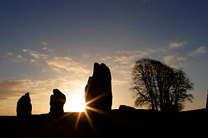 Sunrise over three stone megaliths at Avebury Stone Circle (World Heritage Site) Avebury, Wiltshire, UK - Michael Hutchinson