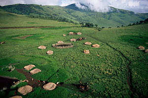 Aerial view of village huts in Crater Highlands, Ngorongoro conservation area, Tanzania.  -  Anup Shah