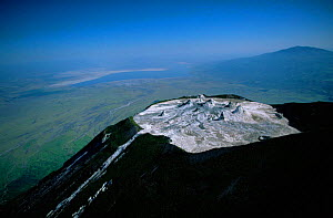 Aerial view of Ol Doinyo Lengai Crater (The Mountain of God) Rift Valley, Tanzania. Note- small cones on crater floor formed by previous eruptions of lava, still active.  -  Anup Shah