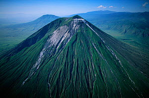 Aerial view of Ol Doinyo Lengai  (The Mountain of God) Volcano, Rift Valley, Tanzania. Note- light gray flows known as 'squeeze-ups' from the highly fluid lava, still active.  -  Anup Shah