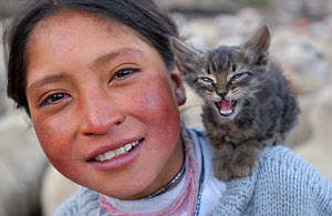 Quichua Indian girl and pet kitten, Chimborazo Reserve,  Andes, Ecuador 2005 - Pete Oxford