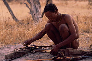 Jo / Hoan bushman with traditional bow and arrows, Bushmanland, Namibia. 1996 - Owen Newman