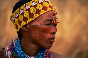 Jo / Hoan bushman with traditional beaded headdress, Bushmanland, Namibia. 1996  -  Owen Newman