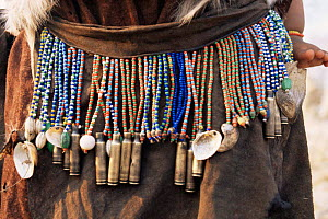 Jo / Hoan bushman traditional beaded jewellery and pipes, Bushmanland, Namibia. 1996  -  Owen Newman