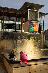 Children play in the water feature at At Bristol Science Museum, Millenium Square, Bristol, UK. 2006 - Warwick Sloss