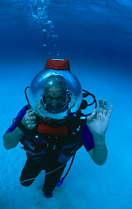 Sir David Attenborough in bubble helmet underwater during filming of BBC television series Trials of Life, 1989 North Bahama Banks  -  Peter Scoones
