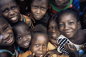 Group of smiling children, Bossue village, Guinea, West Africa, 2000  -  James Aldred