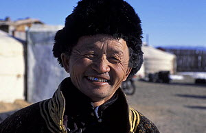 Portrait of nomadic tribesman from Gobi desert, living in traditional yurts, Mongolia.~January 2004.~Filmed for BBC Planet Earth series. - Huw Cordey