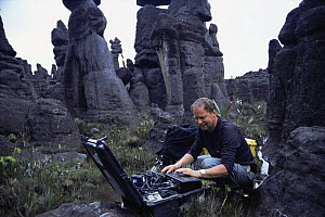 Richard Kirby, camerman on location with timelapse equipment for BBC Planet Earth series, Kukenon, flat top tepuis, southern Venezuela, South America. November 2005  -  Mark Brownlow