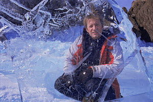 Mark Brownlow, producer of Freshwater programme for BBC Planet Earth series, behind ice sheet, on location at Lake Baikal, world's deepest and oldest (and largest by volume) freshwater lake, Siberia,...  -  Mark Brownlow