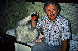 Martin Saunders, cameraman, with joke swan in boat cabin, filming for BBC 'The First Eden' 1985  -  Diana Richards Cronk