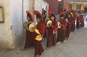 Procession of Nepalese monks, leaving the Gompa for final ceremony inside the village of Lo-Manthang, Upper Mustang, Nepal  -  Bernard Castelein