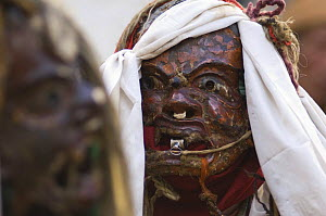 Close-up of Nepalese monk wearing face mask, dressed as a Demon, during 'Duk chu' festival, Lo-Manthang, Upper Mustang, Nepal  -  Bernard Castelein