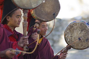 Nepalese monks, playing 'Nha' or hand-drum during 'Duk chu' festival, Lo-Manthang, Upper Mustang, Nepal  -  Bernard Castelein