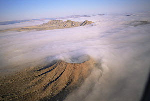 Aerial view of ground fog swirling round Crater Caravajales, Biosphere Reserve of Pinacate and Gran Desierto Altar, Sonora, Mexico  -  Jack Dykinga