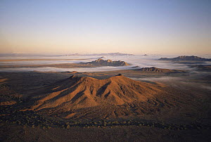 Aerial view of volcanic cinder cone of Cerro Colorado at dawn, Biosphere Reserve of Pinacate and Gran Desierto Altar, Sonora, Mexico  -  Jack Dykinga