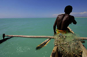 Vezo fisherman out at sea in Pirogue or outrigger canoe Beheloka Vezo fishing village. South-western MADAGASCAR 2005  -  Pete Oxford