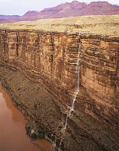 Water from flash floods cascades down Marble Canyon into the Colorado River, Grand Canyon NP, Arizona, USA  -  Jack Dykinga