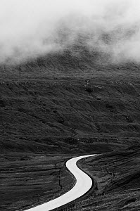Route 10 winding through basalt landscape, near Skagafjordur, Eysturoy, Faroe Islands. June 2006  -  Niall Benvie