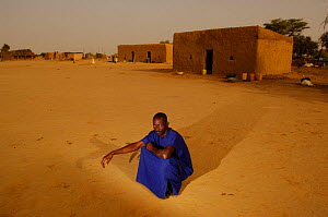 Fulani man sitting in Ari Funda village at dawn, nr Senegal river, South Mauritania, West Africa, 2005  -  Laurent Geslin