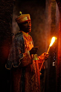 Orthodox christian priest preparing for a christening at Lalibela, North Ethiopia, 2006 - Laurent Geslin
