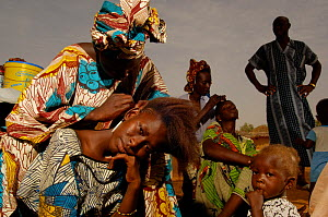 Fulani women braiding their hair, North Senegal, West Africa, 2005  -  Laurent Geslin