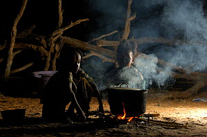Fulani children cooking at night while their parents are busy with the cattle, North Senegal, West Africa, 2005  -  Laurent Geslin