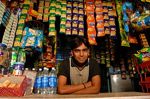 Man selling snacks over counter, India 2006  -  Laurent Geslin