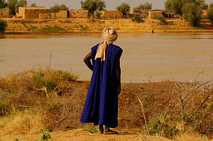 Fulani man looking across the Senegal river to his old village, Ari Funda, on the other side, South Mauritania, West Africa, 2005  -  Laurent Geslin