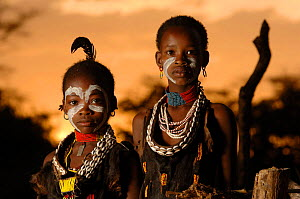 Two young Hamer children display their traditional face paints and costume, Omo valley, Ethiopia, 2006  -  Laurent Geslin