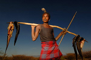 Hamer man returns from fishing with catfish, Omo valley, Ethiopia, 2006 - Laurent Geslin