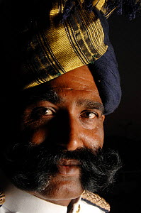 Portrait of traditional Rajasthani man with turban and moustache, Jaipur, Rajasthan, India 2006  -  Laurent Geslin