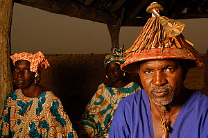 Fulani village chief wearing traditional hat, with his two wives behind, Mauritania, West Africa, 2005  -  Laurent Geslin
