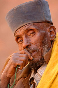 Christian worshipper near St Sauveur's church, Lalibela, North Ethiopia. These worshippers stay for hours in a hole in the carved rock to read their holy books, 2006  -  Laurent Geslin