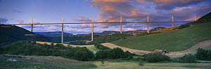 The Viaduct of Millau spanning the Gorge du Tarn with tractor working in the fields, Aveyron, Midi-Pyr�n�es, France  -  David Noton