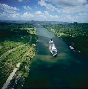 Aerial view of cruise ship, M/V Crystal Symphony, passing through the Panama canal, heading towards Mira Flores Locks, Panama 2005 2006  -  Michael Pitts