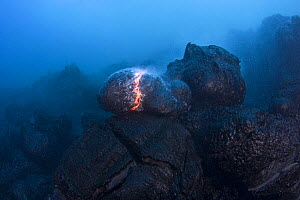 Hot molten pillow lava erupts from an underwater lava tube at ocean entry of Kilauea Volcano on Hawaii Island, Hawaii - Doug Perrine