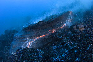 Hot molten pillow lava erupts from an underwater lava tub at ocean entry of eruption from Kilauea Volcano, Hawaii, USA - Doug Perrine