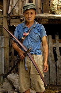 Black Lisu ethnic minority man with crossbow - used to hunt wild animals that live in the hills near Fulong, Nujiang Prefecture, Yunnan Province, China 2006  -  Pete Oxford