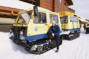 Andrew Cooper, Producer, beside snow buggy at Old Faithfull, Yellowstone NP, Wyoming, USA, January 1999, filming for BBC NHU programme - Andrew Cooper