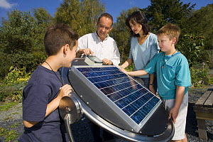 Family with with solar panel display at the Centre for Alternative Technology, Machynlleth, Wales - Nick Turner