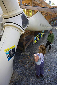 Visitors looking at wind turbine installation at the Centre for Alternative Technology, Machynlleth, Wales  -  Nick Turner